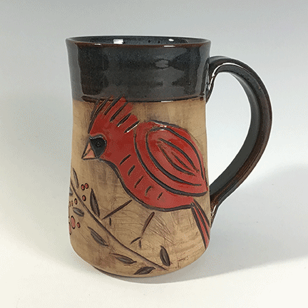 Rectangular ceramic tray featuring male and female cardinals. Lip and handle are glazed in dark slate blue. Body of mug is natural tan clay.